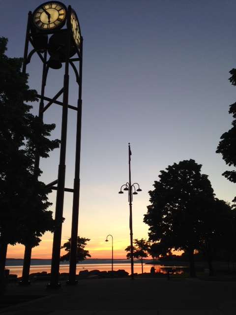 Sunrise, Petoskey Sea wall, Lake Michigan sunrise, clock tower, looking up, the daily post, photography 101